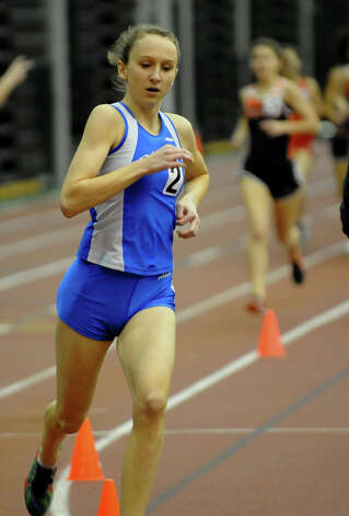 Darien's Grace Loh commands a huge lead as she competes in the 1000 meter event during FCIAC Indoor Track and Field Championships in New Haven, Conn. on Thursday January 18, 2013. Loh won the event. Photo: Christian Abraham / Connecticut Post