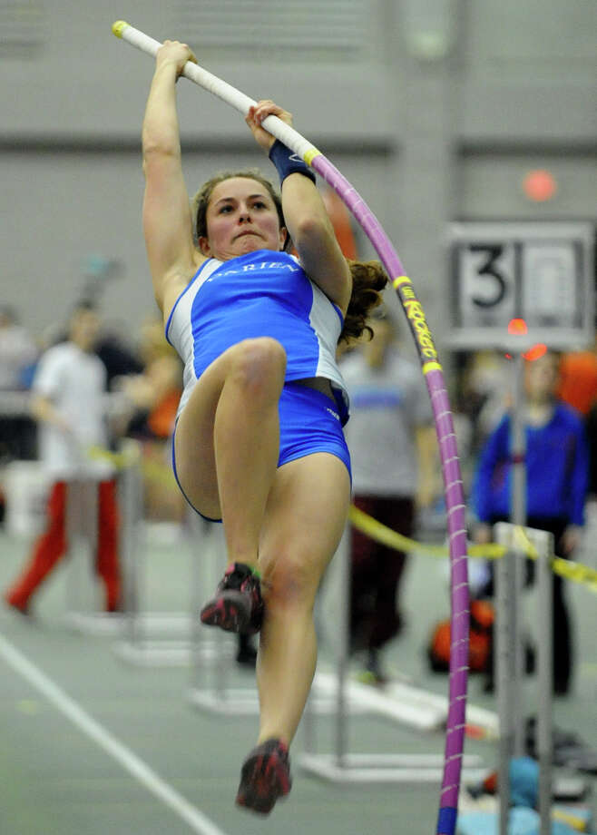 Darien's Maddie Schneider competes in the pole vault event during FCIAC Indoor Track and Field Championships in New Haven, Conn. on Thursday January 18, 2013. Photo: Christian Abraham / Connecticut Post