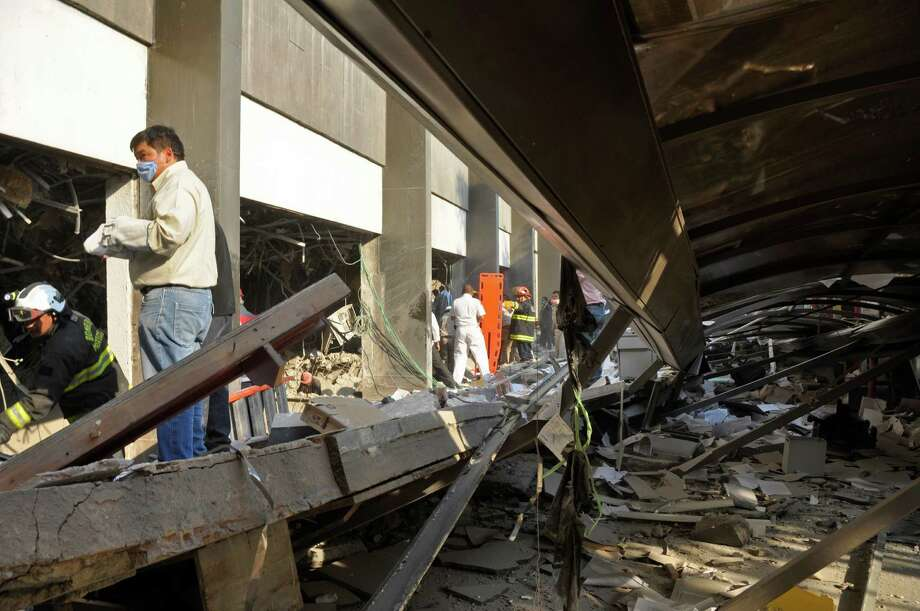 Firefighters and workers dig for survivors trapped after an explosion in a Pemex building in Mexico City. Photo: Guillermo Gutierrez, STR / AP