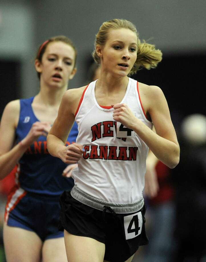 New Canaan's Samantha Santoni competes in the 600 meter race Thursday, Jan. 31, 2013 during the FCIAC indoor track championships at the Floyd Little Athletic Center at Hillhouse High School in New Haven, Conn. Photo: Autumn Driscoll / Connecticut Post
