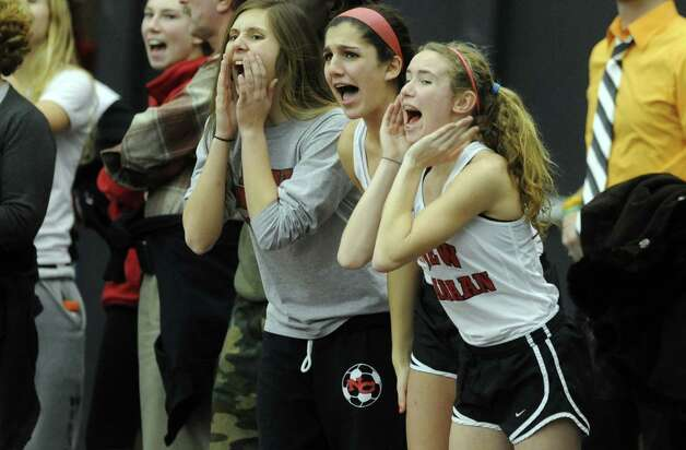 Teammates cheer Thursday, Jan. 31, 2013 during the FCIAC indoor track championships at the Floyd Little Athletic Center at Hillhouse High School in New Haven, Conn. Photo: Autumn Driscoll / Connecticut Post