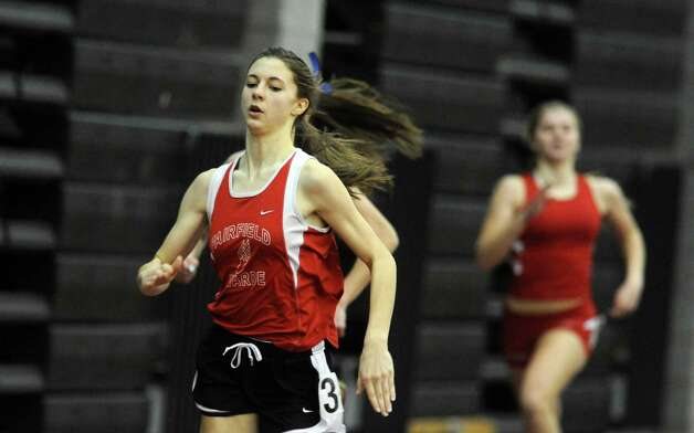 Fairfield Warde's Lia Joham competes in the 300 meter race in first place Thursday, Jan. 31, 2013 during the FCIAC indoor track championships at the Floyd Little Athletic Center at Hillhouse High School in New Haven, Conn. Photo: Autumn Driscoll / Connecticut Post