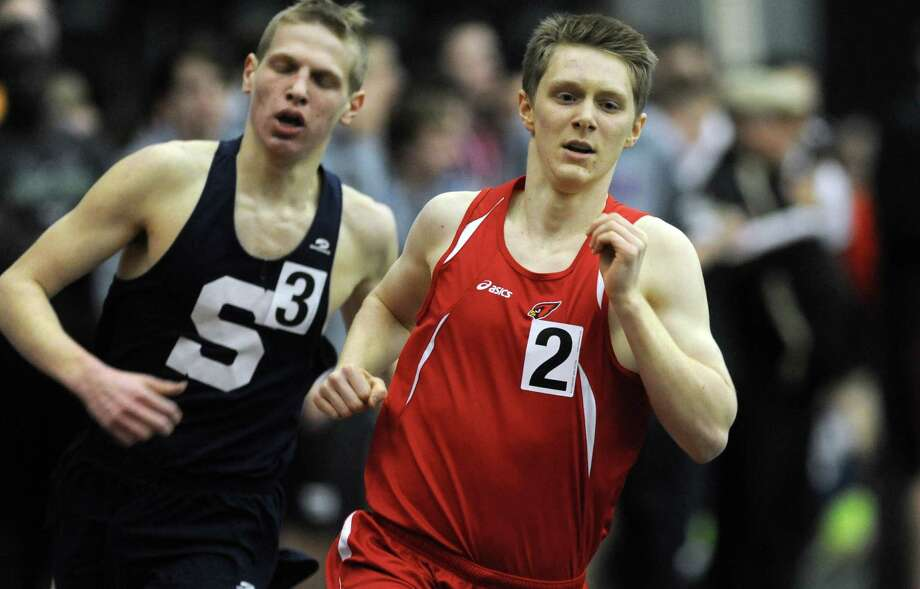 Greenwich's Dan Wilbanks races in the 1000 meter run Thursday, Jan. 31, 2013 during the FCIAC indoor track championships at the Floyd Little Athletic Center at Hillhouse High School in New Haven, Conn. Photo: Autumn Driscoll / Connecticut Post