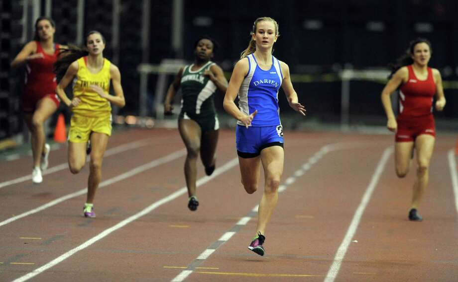 Darien's Anna Sulger competes in the 300 meter race in first place Thursday, Jan. 31, 2013 during the FCIAC indoor track championships at the Floyd Little Athletic Center at Hillhouse High School in New Haven, Conn. Photo: Autumn Driscoll / Connecticut Post