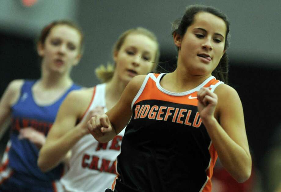 Ridgefield's Hannah Mercorella competes in the 600 meter race Thursday, Jan. 31, 2013 during the FCIAC indoor track championships at the Floyd Little Athletic Center at Hillhouse High School in New Haven, Conn. Photo: Autumn Driscoll / Connecticut Post