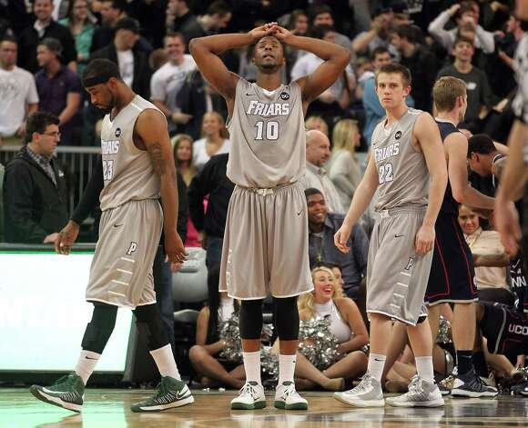 Providence forwards LaDontae Henton (23), Kadeem Batts (10) and guard Ted Bancroft (22) react after teammate guard Bryce Cotton, not pictured, missed a last second 3-pointer to tie the game against Connecticut, Thursday, Jan. 31, 2013, in Providence, R.I. Connecticut won 82-79 in overtime. (AP Photo/Stew Milne) Photo: Stew Milne, Associated Press / FR56276 AP