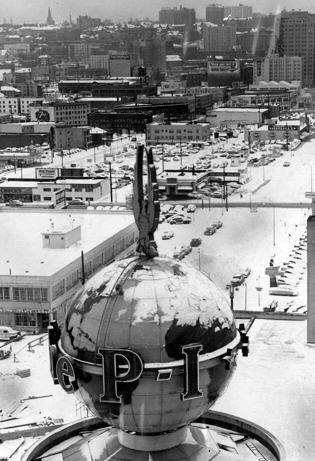 This picture from Jan. 15, 1954, shows ice and snow on the famous P-I globe. When ice melts each year, it rips apart the neon lights causing a costly fix each winter. That also explains why some of the letters don't always work in winter months. Photo: Seattlepi.com