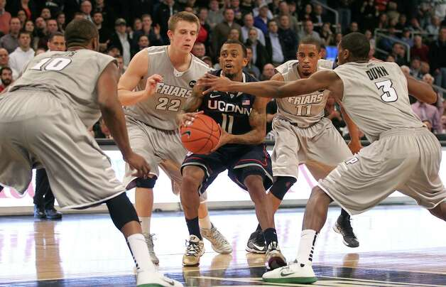 Connecticut guard Ryan Boatright (11) has the ball stripped while being defended by Providence forward Kadeem Batts (10) guards Ted Bancroft (22), Bryce Cotton (11) and Kris Dunn (3) during the overtime of an NCAA college basketball game, Thursday, Jan. 31, 2013, in Providence, R.I. Connecticut won in overtime 82-79. (AP Photo/Stew Milne) Photo: Stew Milne, Associated Press / FR56276 AP