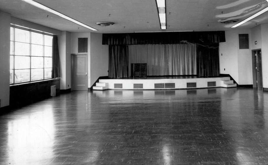 "The auditorium at the Sixth and Wall building was used for ""cooking schools, fashion shows, carrier meetings and other promotional activities of The Post-Intelligencer,"" according to a 1949 article. ""It will also be made available for meetings of civic groups, such as women's and community clubs interested in various phases of the city's welfare and to advertisers for sales meetings, etc. The room will seat more than 300 persons, has a stage and a motion picture projection booth at the rear, equipped to project any size film."" Photo: Seattlepi.com"
