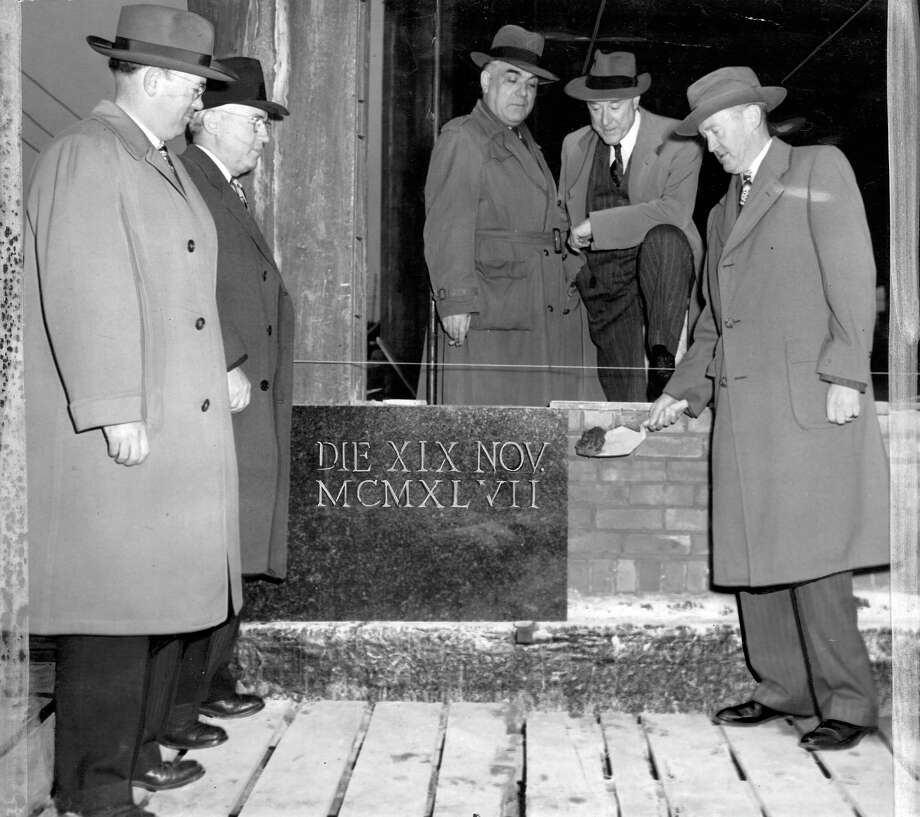"The caption for this image, which was taken Nov. 19, 1947, says ""a piece of black granite, first slab of 800 running feet of black granite base, was laid at the northwest corner of the new Post-Intelligencer building at 5th Ave. and Wall St. yesterday by John J. Callahan, business manager. Looking on are, left to right, Howard S. Wright, John J. Shea. Joseph Geddes and Henry Bittman."" Wright later built the Space Needle for the 1962 World's Fair. Photo: Seattlepi.com"