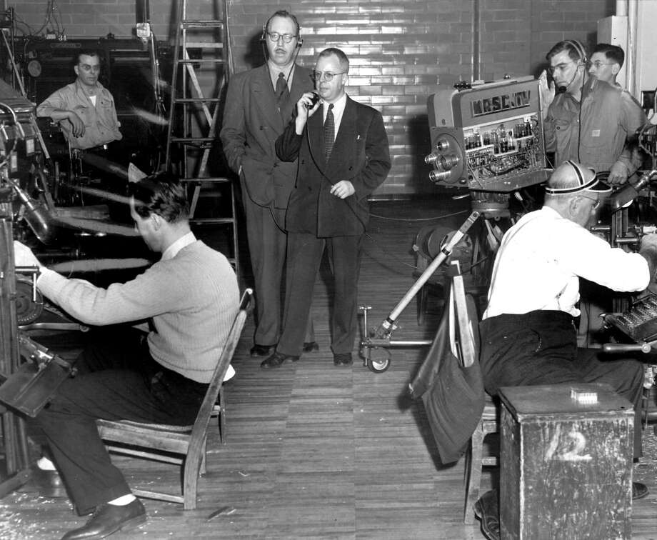 In this picture form Jan. 4, 1949, which was never published in the newspaper, reporter Jack Jarvis tells KRSC-TV about typesetters at the new P-I building. KRSC was around only briefly – starting with the West Seattle vs. Wenatchee Turkey Day game at Memorial Stadium on Nov. 25, 1948 and switching to call letters KING after a May 1949 sale. KING/5 is Seattle's oldest running TV stations, and this is one of the few images of a KRSC crew at work in Seattle. Jack Jarvis, who was known for his quirky business cards, also was a reader-favorite for his daily dispatches from the 1962 World's Fair. Photo: Seattlepi.com