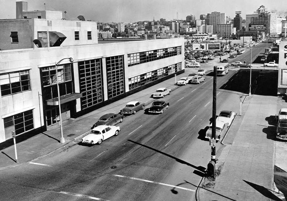 This picture from Aug. 1956 shows the P-I building on the left and the area that was Denny Hill before it was regarded and dumped into Elliott Bay. Vehicles are traveling south on Fifth Avenue. The monorail didn't begin running on Fifth until 1962. Photo: Seattlepi.com