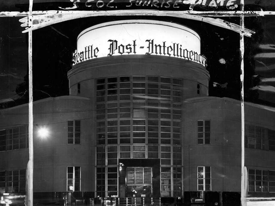 This is an Oct. 1948 picture of the former P-I building, but it wasn't really that bright. White paint was added to increase the light that appeared to be projected on the front of the building. Marks were made by a seattlepi.com photo editor. Photo: Seattlepi.com