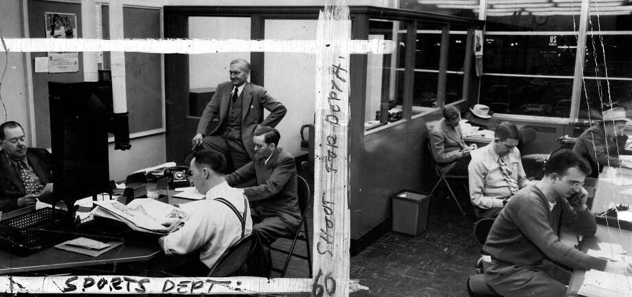 Royal Brougham, legendary P-I writer and editor who has the street next to Safeco Field named for him, is shown here on the third floor of the former P-I building with his sports staff on Jan. 2, 1949. Marks on the image were made by a P-I photo editor. Photo: Seattlepi.com