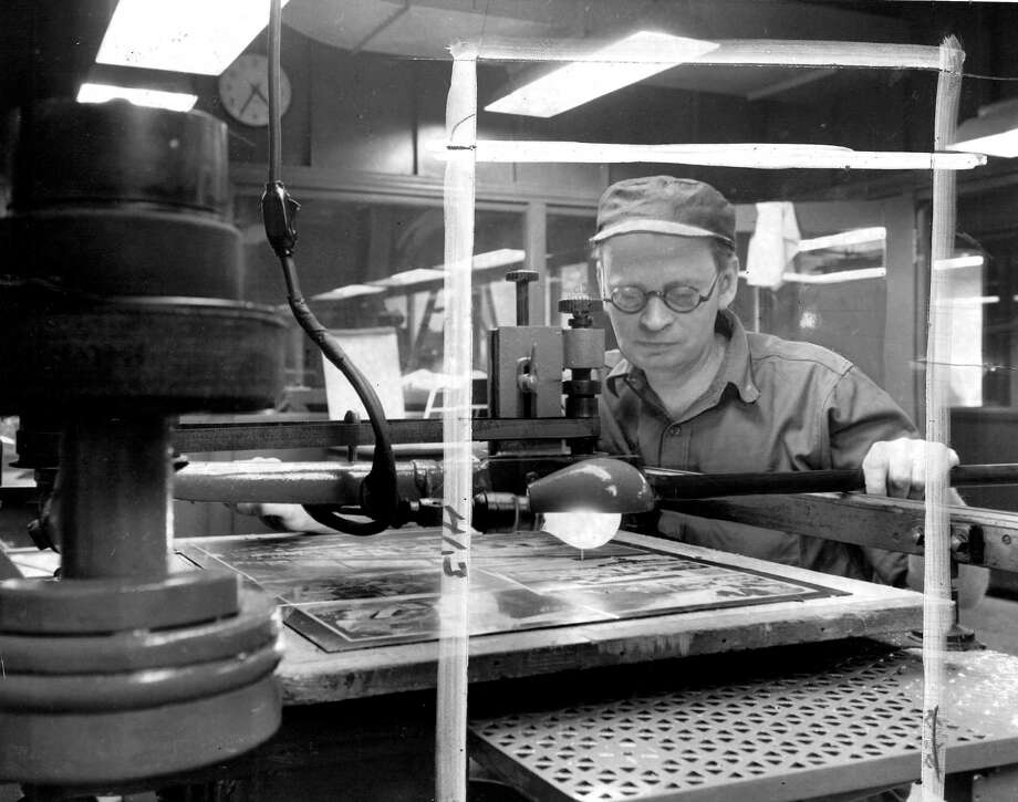 Here's a Jan. 2, 1949 picture of a P-I newspaper plate being routed. Photo: Seattlepi.com