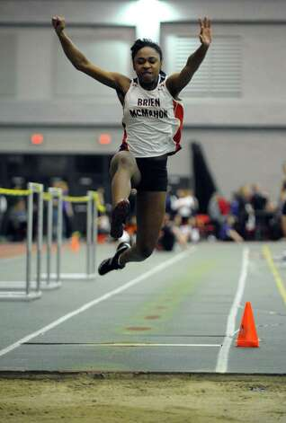 Brien McMahon's Sarah Boyd competes in the long jump event during FCIAC Indoor Track and Field Championships in New Haven, Conn. on Thursday January 18, 2013. Photo: Christian Abraham / Connecticut Post
