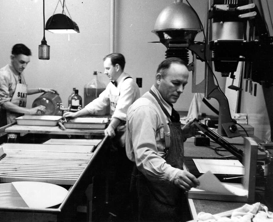 Here's a photo of P-I staff in the darkroom that has only previously run in the employee newsletter. From left: Harvey Davis, Dick Cameron, Stu Hertz. No date is given, but it was likely taken in early 1949. Photo: Seattlepi.com