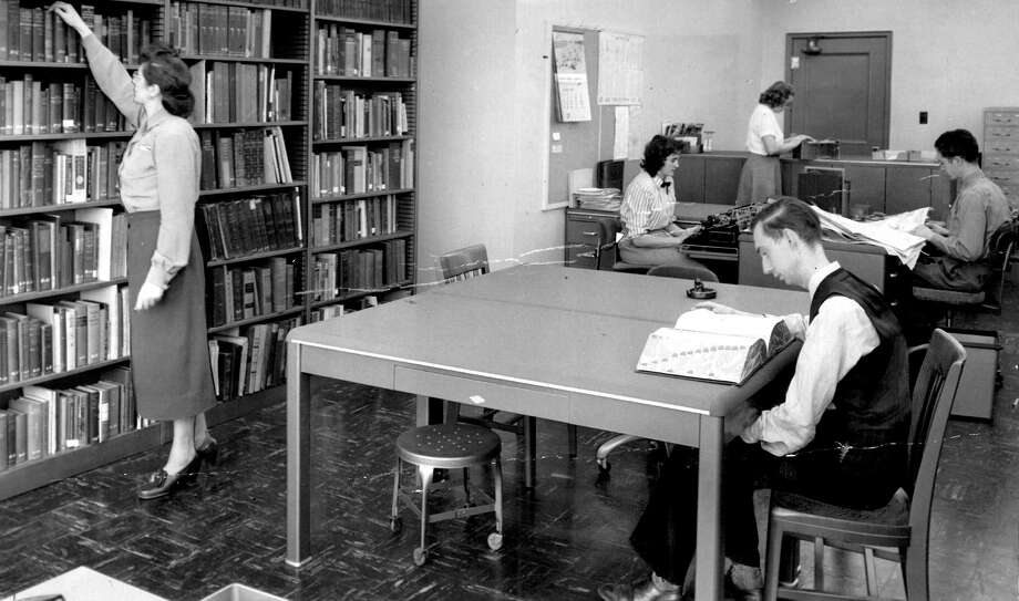 The P-I library was on the third floor of what's now the City University headquarters. Some of the books pictured at left were donated to the Seattle Public Library's Seattle room, and three donations from the Hearst Company sent millions of negatives to the Museum of History and Industry beginning in 1976. Photo: Seattlepi.com