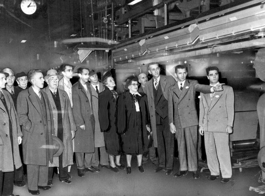 These were some of the first visitors to the P-I headquarters at Sixth Avenue and Wall Street, which is now home to City University of Seattle. The picture from Jan. 3, 1949, shows the newspaper press, which was removed in the early 1980s. The university's atrium is where the press once stood. Photo: Seattlepi.com