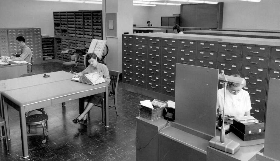 The P-I library was on the third floor, but the space has been completely renovated. The subject index card files in cabinets in the back, shown here in Jan. 1949, are now preserved thanks to staff at the Seattle Public Library's Seattle Room. Photo: Seattlepi.com
