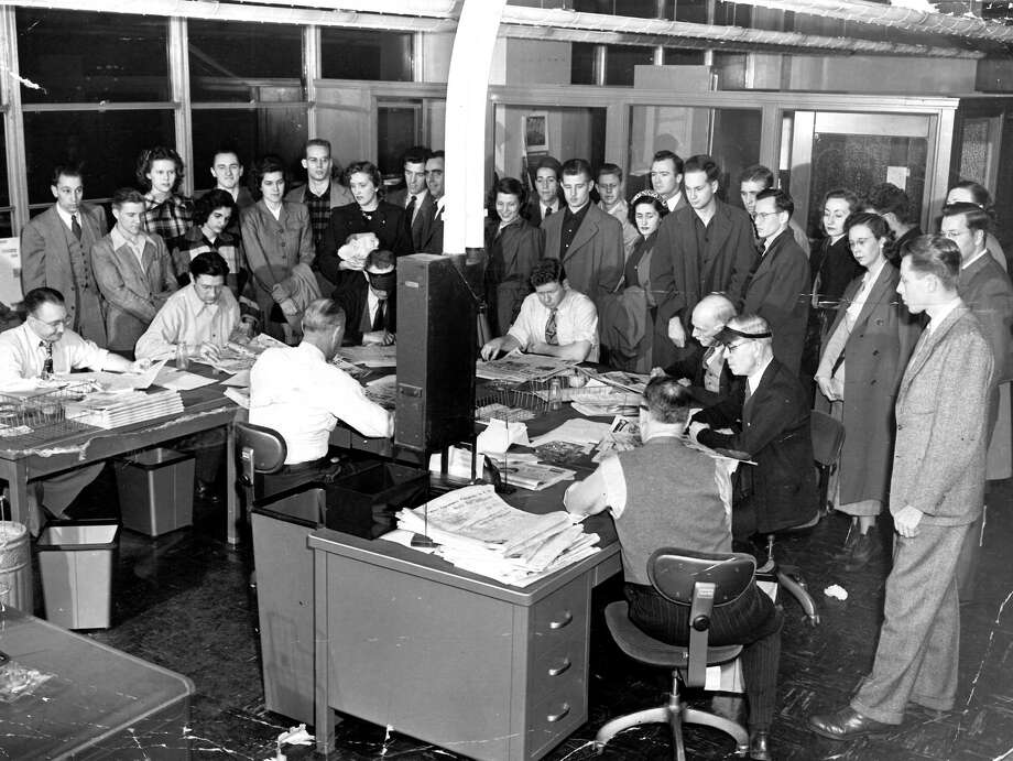 This previously unpublished photo from Jan. 1949 shows visitors to the Seattle P-I newsroom at Sixth Avenue and Wall Street - a building now home to City University of Seattle after major renovations. Photo: Seattlepi.com