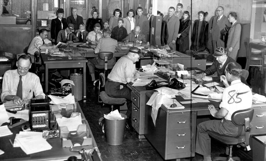 In this picture from Jan. 1949, visitors see the Post-Intelligencer newsroom at Sixth Avenue and Wall Street. The building is now home to City University of Seattle. Marks on the image were made by a P-I photo editor. Photo: Seattlepi.com