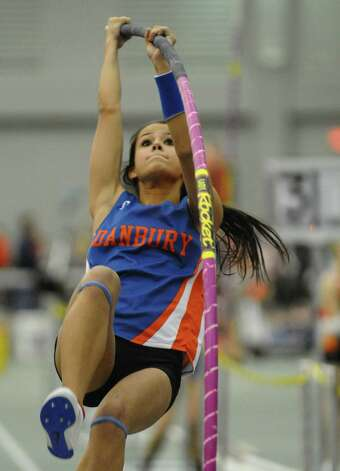 Danbury's Lyzandra Fernandes competes in the pole vault event during FCIAC Indoor Track and Field Championships in New Haven, Conn. on Thursday January 18, 2013. Fernandes finished in fourth place in the pole vault and third in the high jump. Photo: Christian Abraham / Connecticut Post