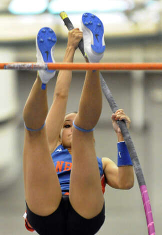Danbury's Lyzandra Fernandes competes in the pole vault event during FCIAC Indoor Track and Field Championships in New Haven, Conn. on Friday January 18, 2013. Fernandes finished in fourth place in the pole vault and third in the high jump. Photo: Christian Abraham / Connecticut Post