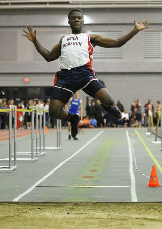 McMahon's Tavon Kinder competes in the long jump event during FCIAC Indoor Track and Field Championships in New Haven, Conn. on Thursday January 18, 2013. Photo: Christian Abraham / Connecticut Post