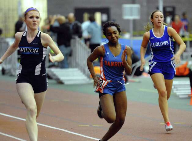 Wilton's Shannon Quinlan, left, Danbury's Niema Riley, center, and Lindsey Evans compete in the 55 meter dash event during FCIAC Indoor Track and Field Championships in New Haven, Conn. on Thursday January 18, 2013. Photo: Christian Abraham / Connecticut Post