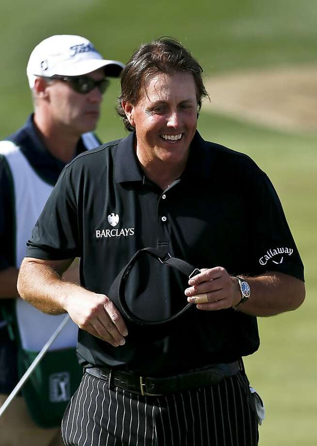 Phil Mickelson appears in good spirits after a great round that could have been greater. Photo: Ross D. Franklin, Associated Press