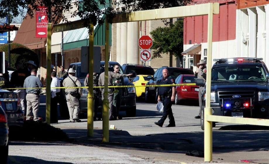 Law enforcement officers investigate at the scene after Assistant District Attorney Mark Hasse, a onetime Dallas County prosecutor, was shot to death by a masked gunman Thursday morning in Kaufman. Photo: David Woo, MBR / Dallas Morning News