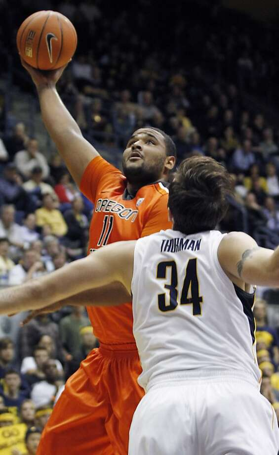 Oregon State's Joe Burton shoots as California's Robert Thurman defends during the first half of an NCAA college basketball game in Berkeley, Calif., Thursday, Jan. 31, 2013. (AP Photo/George Nikitin) Photo: George Nikitin, Associated Press