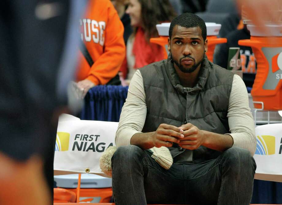 Syracuse's James Southerland, who did not play due to academic issues, sits on the bench during the first half of an NCAA college basketball game against Villanova in Syracuse, N.Y., Saturday, Jan. 12, 2013. (AP Photo/Kevin Rivoli) Photo: KEVIN RIVOLI / FR60349 AP