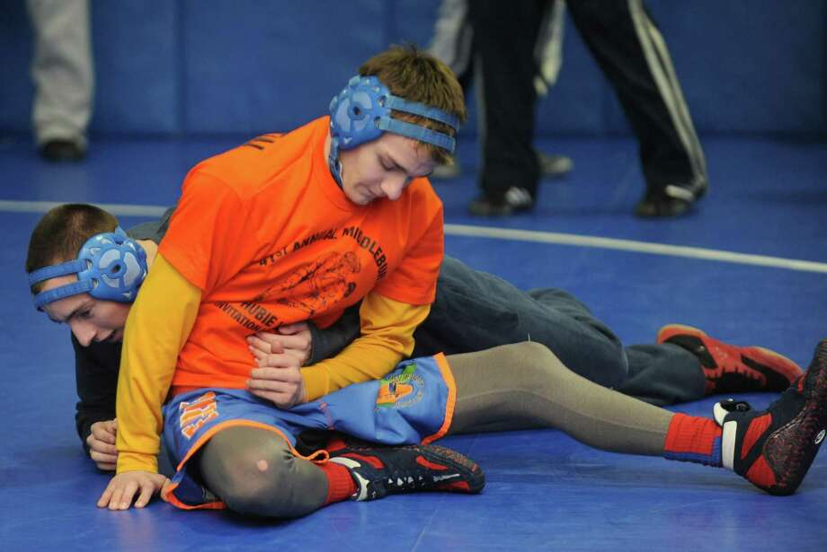 Shaker High School wrestler Blake Retell works out with teammate Beau Lynch during practice on Tuesday Jan.22,2013 in Latham, N.Y. (Michael P. Farrell/Times Union) Photo: Michael P. Farrell