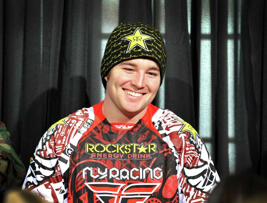 In this photo taken Jan. 25, 2012 and released by ESPN Images, snomobiler Caleb Moore smiles while attending a news conference at the Winter X Games in Aspen, Colo. Moore was in critical condition on Tuesday, Jan. 29, 2013, in a Colorado hospital after a dramatic crash at the Winter X Games in Aspen, and a relative said the family wasn't hopeful about the 25-year-old's chances for survival. (AP Photo/ESPN Images, Eric Lars Bakke) Photo: Eric Lars Bakke