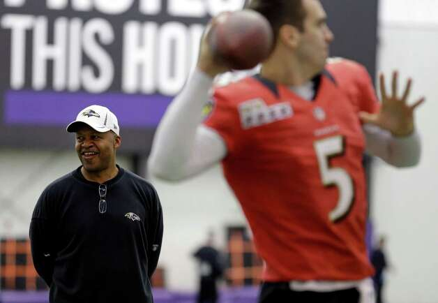 Baltimore Ravens offensive coordinator Jim Caldwell, back left, looks on as quarterback Joe Flacco warms up during NFL football practice at the team's training facility in Owings Mills, Md., Friday, Jan. 25, 2013. The Ravens are scheduled to face the San Francisco 49ers in Super Bowl XLVII in New Orleans on Sunday, Feb. 3. (AP Photo/Patrick Semansky) Photo: Patrick Semansky / AP