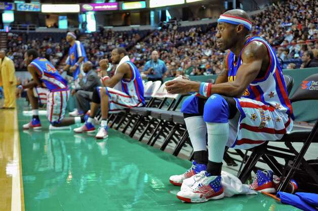 "Harlem Globetrotter ""Firefly,"", aka Siena graduate Tay Fisher, takes a breather at the Times Union Center during a game on Sunday Feb. 5, 2012 in Albany, NY.    (Philip Kamrass / Times Union ) Photo: Philip Kamrass / 00016336A"