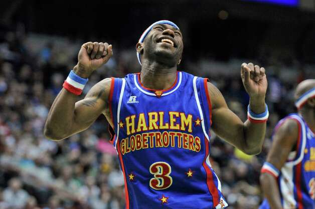 "Harlem Globetrotter ""Firefly,"", aka Siena graduate Tay Fisher, entertains the crowd at the Times Union Center during a game on Sunday Feb. 5, 2012 in Albany, NY.    (Philip Kamrass / Times Union ) Photo: Philip Kamrass / 00016336A"