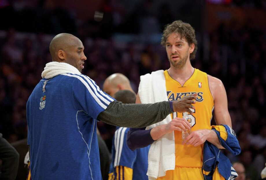 Los Angeles Lakers guard Kobe Bryant, left, talks with forward Pau Gasol, of Spain, during the first half of their NBA basketball game against the against the New Orleans Hornets, Tuesday, Jan. 29, 2013, in Los Angeles. (AP Photo/Mark J. Terrill) Photo: Mark J. Terrill, STF / AP