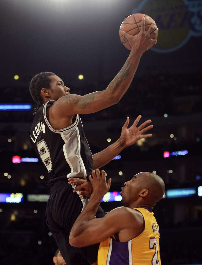 Kawhi Leonard (2) of the Spurs is called for a charge on Kobe Bryant (24) of the Lakers at Staples Center on Nov. 13, 2012 in Los Angeles. Photo: Harry How, Getty Images / 2012 Getty Images