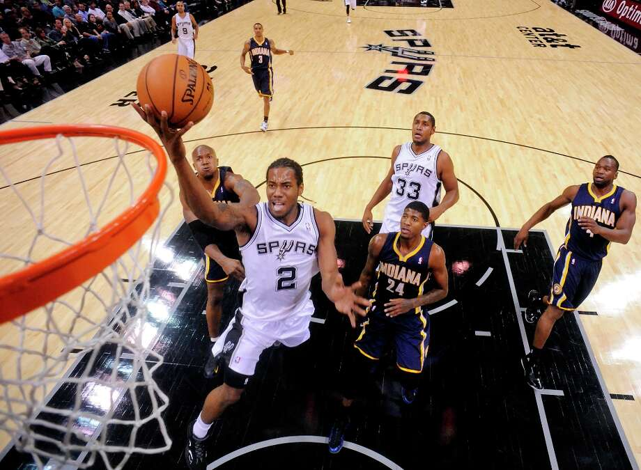 The Spurs' Kawhi Leonard shoots between the Pacers' David West (left) and Paul George during second half action Monday Nov. 5, 2012 at the AT&T Center. The Spurs won 101-79. Photo: Edward A. Ornelas, San Antonio Express-News / © 2012 San Antonio Express-News