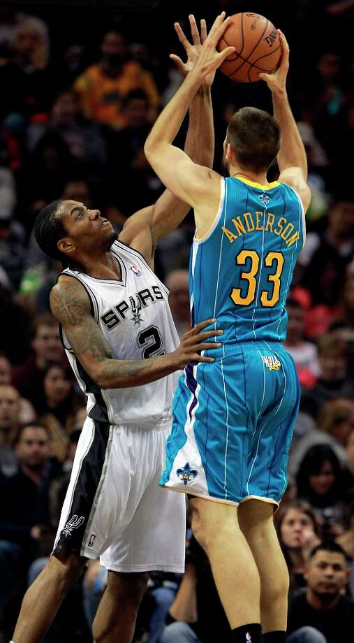Kawhi Leonard defends against Ryan Anderson as San Antonio plays the New Orleans Hornets at the  AT&T Center on December 21, 2012. Photo: Tom Reel, San Antonio Express-News / ©2012 San Antono Express-News