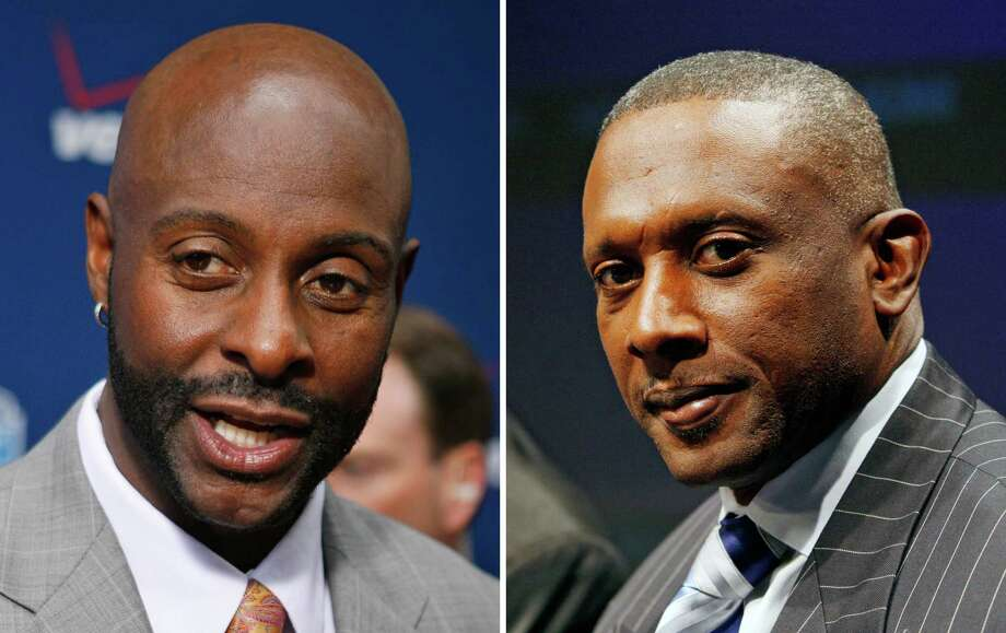 """FILE - At left, in an April 22, 2010 file photo, Jerry Rice talks to reporters at the NFL Draft in New York. At right, in An April 30, 2009 file photo, Tim Brown speaks at the announcement of the 2009 College Hall of Fame class at NASDAQ Marketsite in New York. Former Oakland coach Bill Callahan has denied allegations made by two of his former players that he """"sabotaged"""" the Raiders in their Super Bowl loss to Tampa Bay 10 years ago. Former Raiders receivers Brown and Rice both said in recent interviews they believe Callahan undermined his own team in the Super Bowl in 2003 because of his close friendship with Tampa Bay coach Jon Gruden by altering the game plan less than two days before Oakland's 48-21 loss. (AP Photo/File) Photo: STF / AP"""