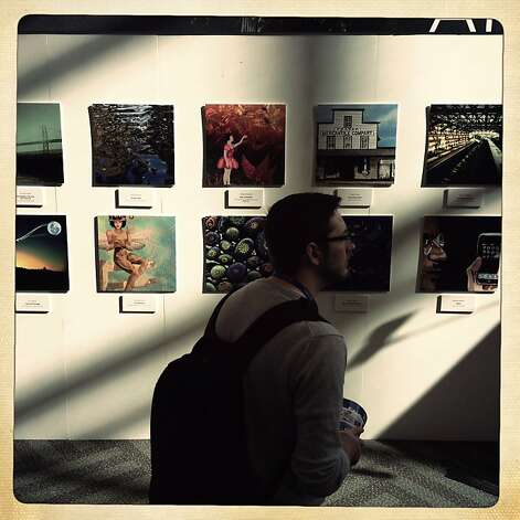 Jake Zimmer of Tahoe City checks out artwork in the Digital Art Gallery at Macworld/iWorld in the Moscone Center in S.F. Mobile photography is taking off. Photo: Lea Suzuki, The Chronicle