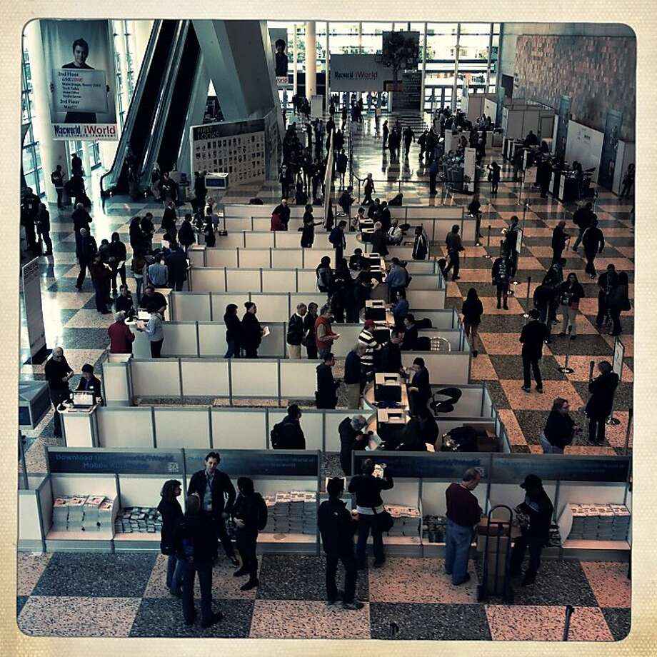 Macworld/iWorld attendees register and walk through the lobby of Moscone Center West on Thursday, January 31, 2013 in San Francisco, Calif. Photo: Lea Suzuki, The Chronicle