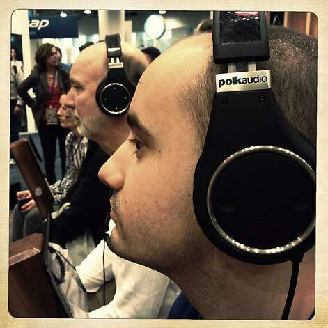 Michal Andrzej Dabrowski of Poland tries out UltraFocus 8000 Active Noise Cancelling Headphones at the Polk booth in the expo hall at Macworld/iWorld in Moscone Center West on Thursday, January 31, 2013 in San Francisco, Calif. Photo: Lea Suzuki, The Chronicle