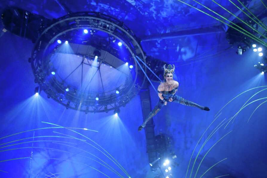 Aerial performers swing high overhead during Cirque du Soleil's Amaluna.
