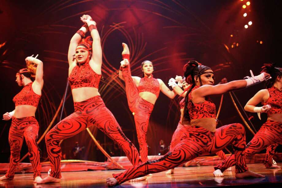 Performers strike a pose during an uneven bars performance. Photo: JOSHUA TRUJILLO, SEATTLEPI.COM / SEATTLEPI.COM
