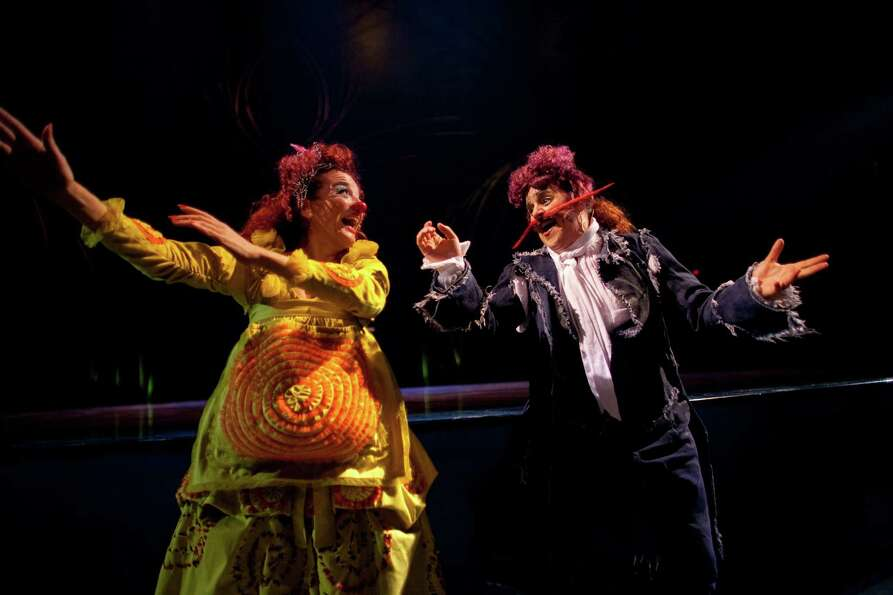 Clowns Josepa Plana Llort, left, and Nathalie Claude perform.